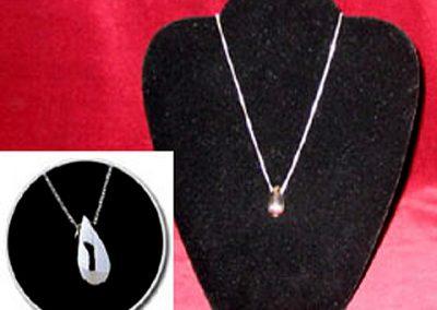 Sterling Silver Tear Drop Keepsake Pendant: $170