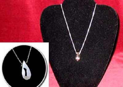 Sterling Silver Tear Drop Keepsake Pendant: $170